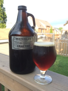 Growler and glass full of Waterloo Smoked Applewood Roggenbier